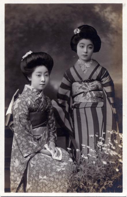 Two onnanoko [young women] posing, c. 1910.
