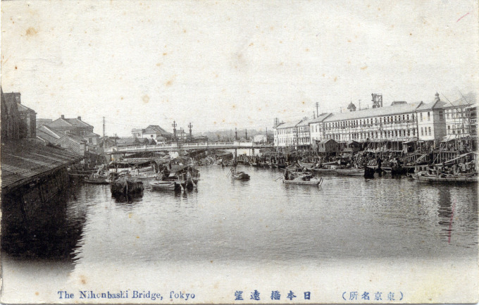 Nihonbashi Bridge, looking west past canal-side warehouses and fish markets, c. 1910.