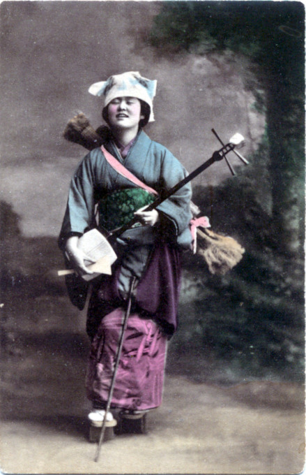 Samisen player, c. 1910.