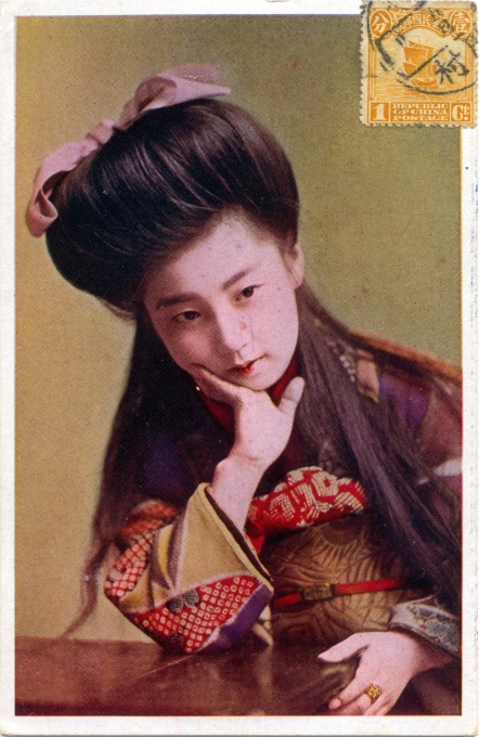 Bijin (pretty girl) posting with Western coiffure, c. 1910.