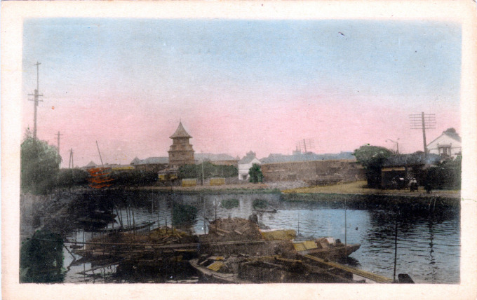 The tower of Rikkyo University rises above the foreign settlement at Tsukiji, c. 1900.