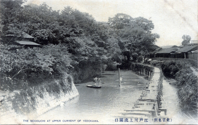 A 'suidobashi' [water bridge], or aqueduct, coursing along the upper reaches of the Yedogawa, Tokyo,  c. 1910.