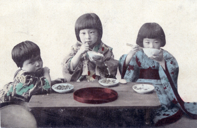 Children eating lunch, c. 1910.