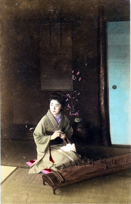 Koto player and ikebana, c. 1910.