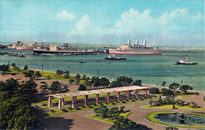 Yamashita Park, Yokohama, with the Hikawa Maru (black hull) berthed at center, c. 1960.