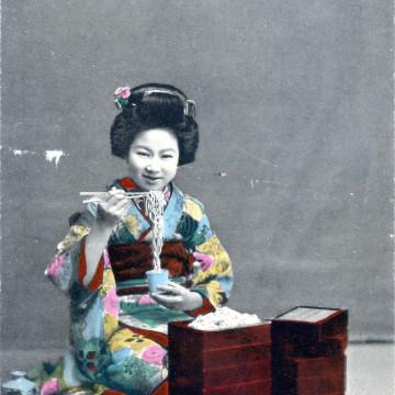 Eating noodles, c. 1910.