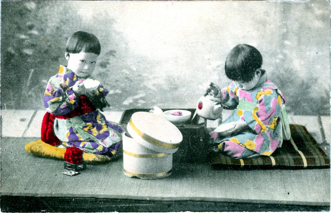 Children with bowls of rice, c. 1910.