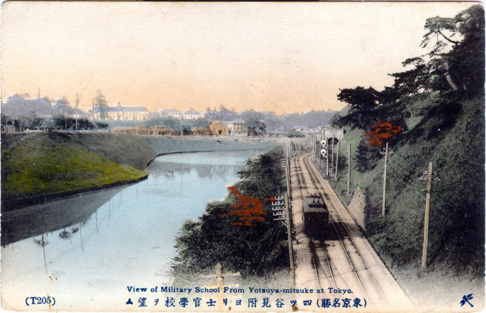The Kanda River at Yotsuya-mitsuke, c. 1910. In the distance is the Imperial Army Academy at Ichigaya.
