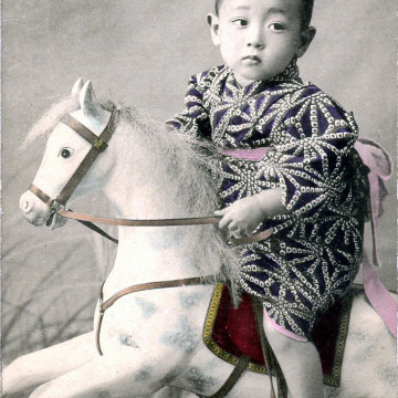 Child with hobby horse, c. 1910.