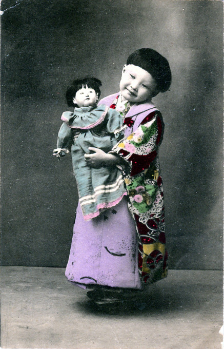 Child with doll, c. 1910.