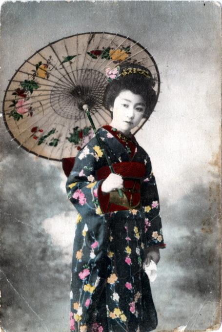 Onnanoko with Japanese umbrella, c. 1910.