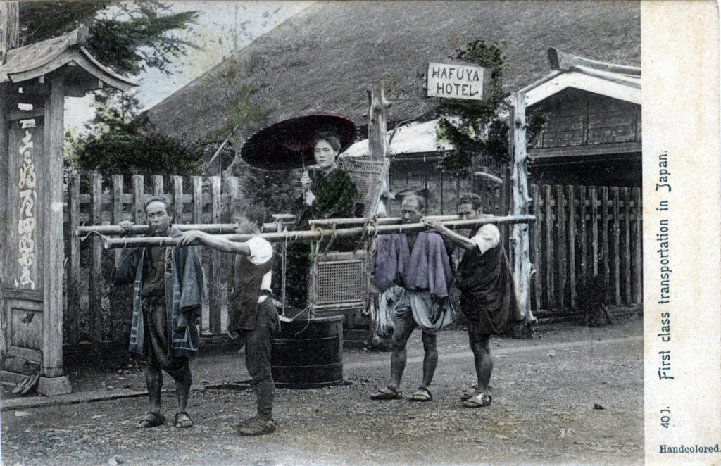 Woman in palanquin in front of Hafuya Shirozaemon hotel on the shores of Lake Ashino, c. 1900.