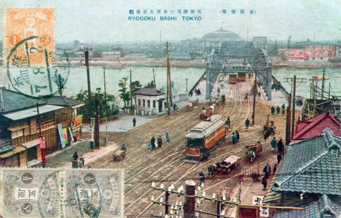 Elevated view of Ryogoku Bridge, c. 1910, with Kokugikan in the distance.